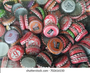 Nong Bua Lamphu, Thailand - CIRCA AUGUST,2017 : Top view of a group of assorted soda bottle caps. The caps include Coca-Cola, Minute Maid Splash, RC, and Siam Winery.