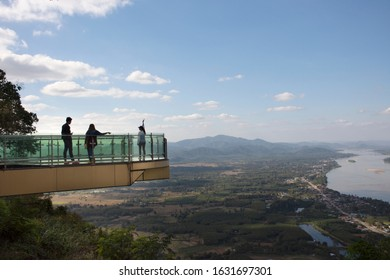 NONG KHAI, THAILAND - DECEMBER 19 : Travelers thai people travel visit and posing for take photo view on glass skywalk of cliffs at Wat Pha Tak Suea temple on December 19, 2017 in Nongkhai, Thailand