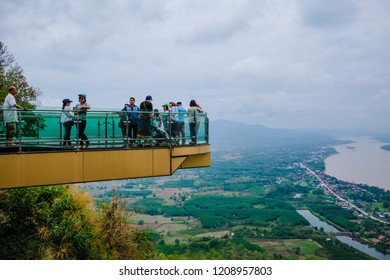 Nong Khai, Thailand - July 28, 2018 : Many people stand on sky walk at wat pha tak sue.