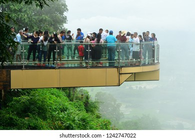 Nong Khai,THAILAND - Sunday‎, ‎July‎ ‎29‎, 2018: The Tourists are shooting photograph on SkyWalk. SkyWalk is a clear glass walkway to view the Mekong River.