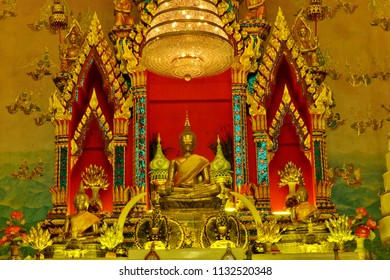 NONG KHAI/THAILAND - JUL 15: The Golden Buddha with Painting Wall of Wat Pho Chai Temple on October 20, 2012 in Nong Khai, Thailand