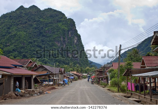 NONG KHIAW, LAOS - AUGUST 14: View of a road in a village on August 14, 2012 in Nong Khiaw, Laos. Nong Khiaw is a rustic little town on the bank of the Ou River.