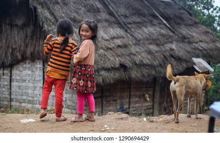 Nong Khiaw, Laos – December 13, 2018: Hmong hill tribe girls in a village near Nong Khiaw in northern Laos. Hmong are ethnic group living in mountains of China, Vietnam, Laos and Thailand.