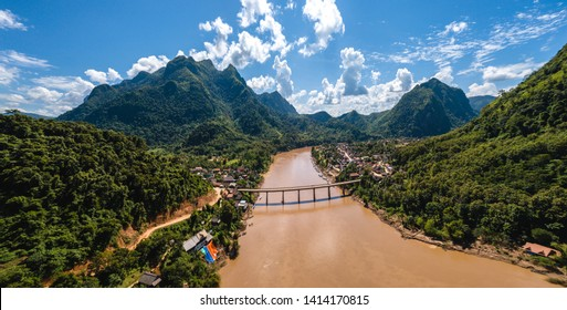 Nong Khiaw panoramic view over Nam Ou River valley Laos national flag scenic mountain landscape famous travel destination in South East Asia