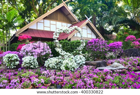 Nong Nooch Tropical Botanical Garden in Pattaya, decorative house among flowers Bougainvillea, Thailand