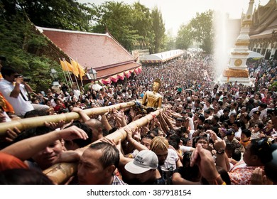 NONGKHAI THAILAND APRIL 13: Songkran Festival, The people pour water and join parade of the statue of Luang Pho Phra Sai with respect to faith on April 13, 2014 in Nongkhai Thailand.