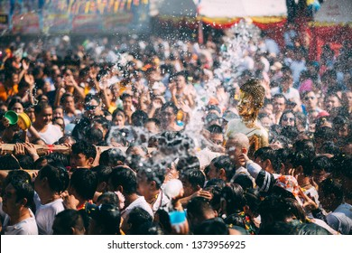 NONGKHAI THAILAND APRIL 18 , 2019 : Songkran Festival, Many people have raised the buddha statues Luang Pho Phra Sai joined parade to pray closely at Nongkhai Thailand