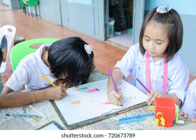 NONGKHAI, THAILAND-SEPTEMBER 13, 2017: The children in primary school of Thailand. They are helping to paint.
