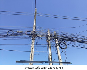 Nongkhai,Thailand-November 01,2018:Wire assemblage a lot of cables and wires on pole with blue sky background.