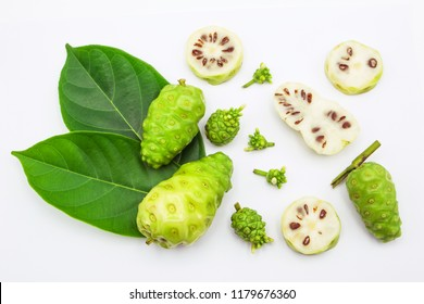 noni flower or morinda citrifolia and noni fruit slice top view on white background.