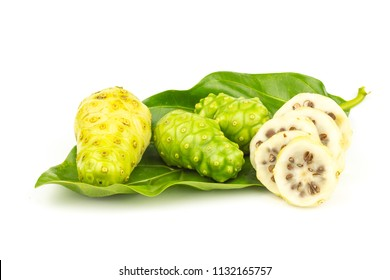 Noni fruit with green leaf on white background.