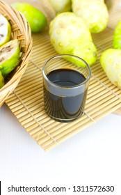 Noni juice or noni juice extracted or organic noni juice or morinda juice .jpg