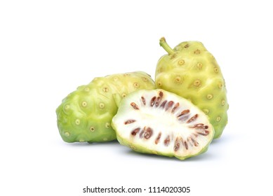 Noni or Morinda Citrifolia fruits with half slice isolated on white background (Rubiaceae Noni, great morinda, indian mulberry, beach mulberry, cheese fruit, Gentianales)
