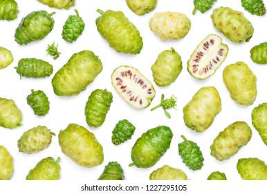 Noni or Morinda Citrifolia fruits pattern on white background (Rubiaceae Noni, great morinda, indian mulberry, beach mulberry, cheese fruit, Gentianales)