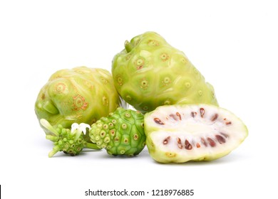 Noni or Morinda Citrifolia fruits with sliced isolated on white background (Rubiaceae Noni, great morinda, indian mulberry, beach mulberry, cheese fruit, Gentianales)