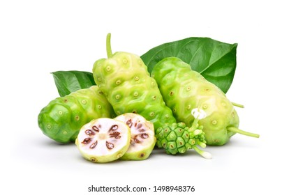 Noni or Morinda Citrifolia fruits with sliced and green leaf isolated on white background (Rubiaceae Noni, great morinda, indian mulberry, beach mulberry, cheese fruit, Gentianales)