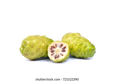 Noni or  Morinda Citrifolia (Rubiaceae Noni, great morinda, indian mulberry, beach mulberry, cheese fruit, Gentianales) fruit  isolated on white background, Thai herb