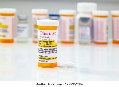 A Non-Proprietary Generic Medication Prescription with medicine pills on a white table