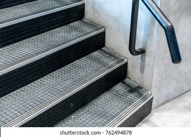 Non-slip stairs with dot pattern close up for background. Black rubber stairs.