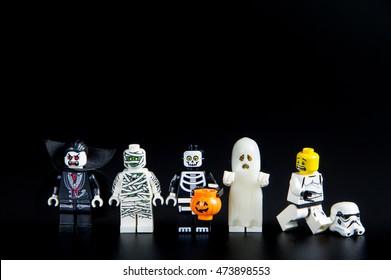 Nonthabure, Thailand - August, 23, 2016: Lego star wars stormtrooper running away ghost halloween.Theme Halloween background.Lego is an interlocking brick system collected around the world.