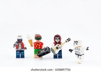 Nonthabure, Thailand - March, 23, 2018 : Lego mini figure playing music on vacation day isolated on white background.Nonthabure, Thailand