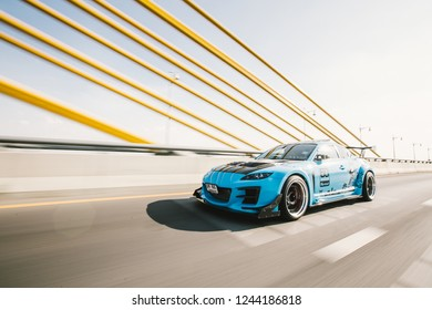 Nonthaburi - Nov 2018 : Blue Mazda RX8 with 2Jz-GTE rolling shot by vapixs on the bridge in Nonthaburi,Thailand. Mazda RX8 full modified and customed with Brembo break and top secret parts and etc.