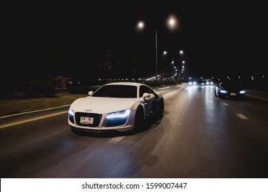 Nonthaburi , Nov 2019 : Side view rolling shot with White Audi R8 and Dark grey Audi TTS in Nagaoka racing team on the street.