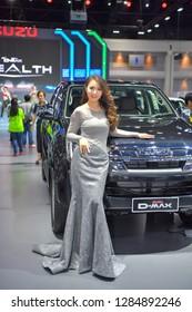 NONTHABURI - NOVEMBER 28:  Unidentified model with Isuzu MU-X The Iconic SUV on display at The 35th Thailand International Motor Expo on November 28, 2018 in Nonthaburi, Thailand.