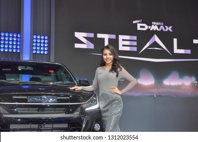 NONTHABURI - NOVEMBER 28:  Unidentified model with Isuzu D-MAX Stealth pick up on display at The 35th Thailand International Motor Expo on November 28, 2018 in Nonthaburi, Thailand.