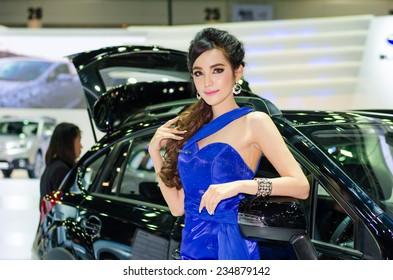 NONTHABURI - NOVEMBER 29: Subaru Forester car with unidentified model on display at Thailand International Motor Expo 2014 on November 29, 2014 in Nonthaburi, Thailand.