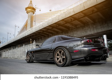 Nonthaburi - Sep 29, 2018 : Vapixs Photography Service Shooting with Black Mazda RX7 fd3s on street in Nonthaburi,Thailand. Black Mazda RX7 fd3s with Volk Racing TE37 Wheels and Endless Break