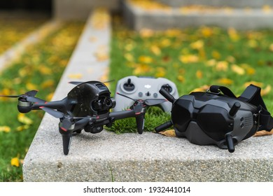 Nonthaburi, Thailand - 3 March 2021 : Clear images of DJI's first FPV drone were placed on a marble floor in the park with a remote and goggles.