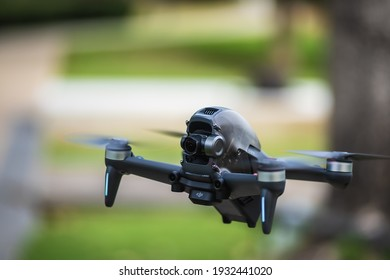 Nonthaburi, Thailand - 3 March 2021 : Candid images of the DJI's first FPV drone in flight against a garden background.