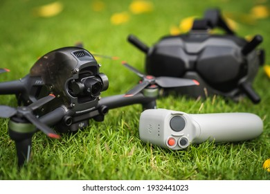 Nonthaburi, Thailand - 3 March 2021 : Candid images of the DJI's first FPV drone were placed on the grass with a remote and goggle.