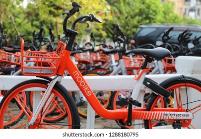 NONTHABURI, THAILAND 6 January 2019, Orange bicycles in bike sharing project, scan and ride by MOBIKE with natural background. Mode of transportation to save energy for global warming reduction.
