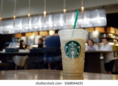 Nonthaburi, Thailand - April 13, 2018 : Cup of Starbucks coffee in the background of Starbucks coffee shop ,Starbucks is the largest coffeehouse company in the world