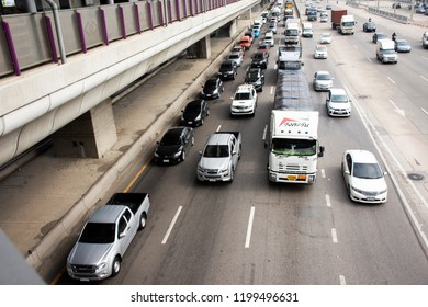NONTHABURI, THAILAND - APRIL 27 : Thai people drive and ride on Kanchanaphisek Road with traffic jam near MRT Purple Line at Bang Pai station on April 27, 2018 in Nonthaburi, Thailand