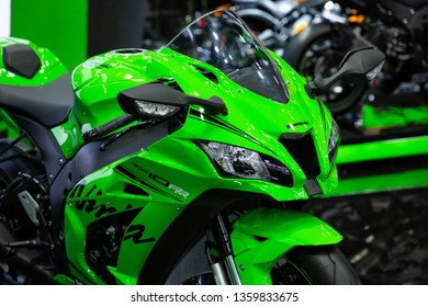 Nonthaburi , Thailand - April 3, 2019: close up headlights front view of Kawasaki zx 10 rr bigbike green color presented in motor show thailand .