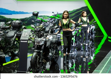 Nonthaburi , Thailand - April 3, 2019: Kawasaki z650 bigbike and pretty women presented in motor show thailand .