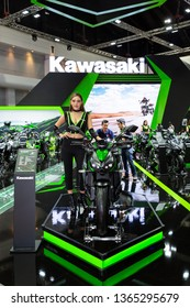 Nonthaburi , Thailand - April 3, 2019: Kawasaki z1000 green color bigbike and pretty women presented in motor show thailand .