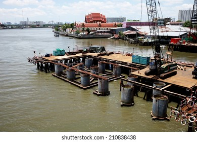 NONTHABURI -THAILAND - AUGUST 12 : Concrete bridge across Chaophraya river under-construction of its deep long pile foundation on August 12, 2014 in Nonthaburi, Thailand