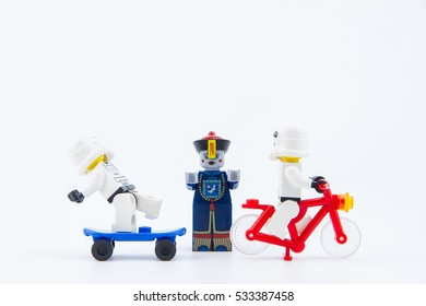 Nonthaburi, Thailand - December, 08, 2016: Lego star wars stormtrooper escape Lego Chinese zombie ghost with fear on isolated white background with copy space.