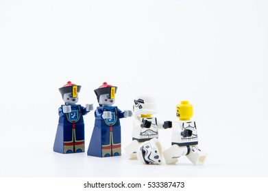 Nonthaburi, Thailand - December, 08, 2016: Lego star wars stormtrooper running away Lego Chinese zombie ghost with fear on isolated white background with copy space.