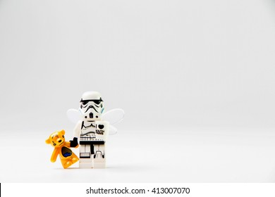 Nonthaburi, Thailand - December 29, 2015: Lego stormtrooper holding a doll.The lego Star Wars  from movie series, Lego is an interlocking brick system collected around the world.
