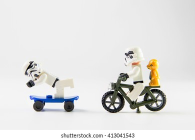 Nonthaburi, Thailand - December 29, 2015: Lego stormtrooper ride a bicycle.The lego Star Wars  from movie series, Lego is an interlocking brick system collected around the world.