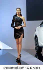 NONTHABURI, THAILAND - DECEMBER 8: Unidentified female model posts at the Lexus Booth during the 32nd Thailand International Motor Expo 2015 on December 8, 2015 in Nonthaburi, Thailand.