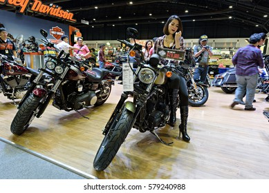 NONTHABURI, THAILAND - DECEMBER 8: Unidentified female model posts at the Harley Davidson Booth during the 32nd Thailand International Motor Expo 2015 on December 8, 2015 in Nonthaburi, Thailand.