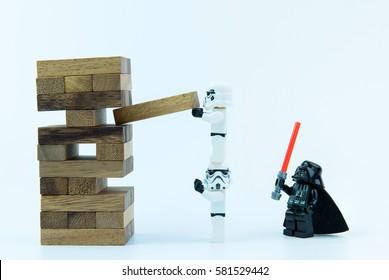 Nonthaburi, Thailand - February, 16, 2017 : Lego star wars stormtrooper playing construction wood blocks stack jenga game on white background copy space.Nonthaburi, Thailand