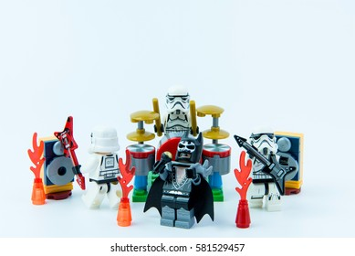 Nonthaburi, Thailand - February, 16, 2017 : Lego star wars stormtrooper and Lego Batman playing music rock band on white background copy space.Band of musicians.Nonthaburi, Thailand