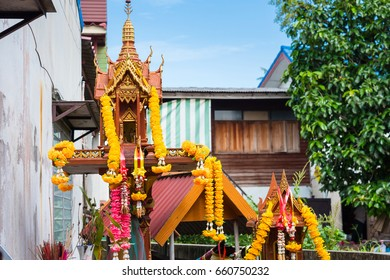 Nonthaburi, Thailand - June, 11, 2017 : View of a Thai spirit house with wooden penises at Koh Kred in Nonthaburi, Thailand.